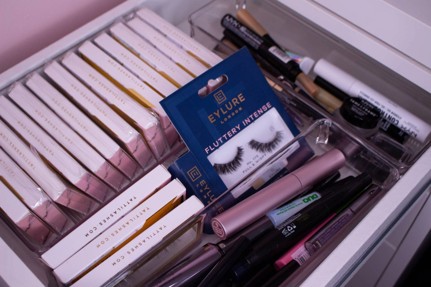 lashes and eye makeup stored in drawer