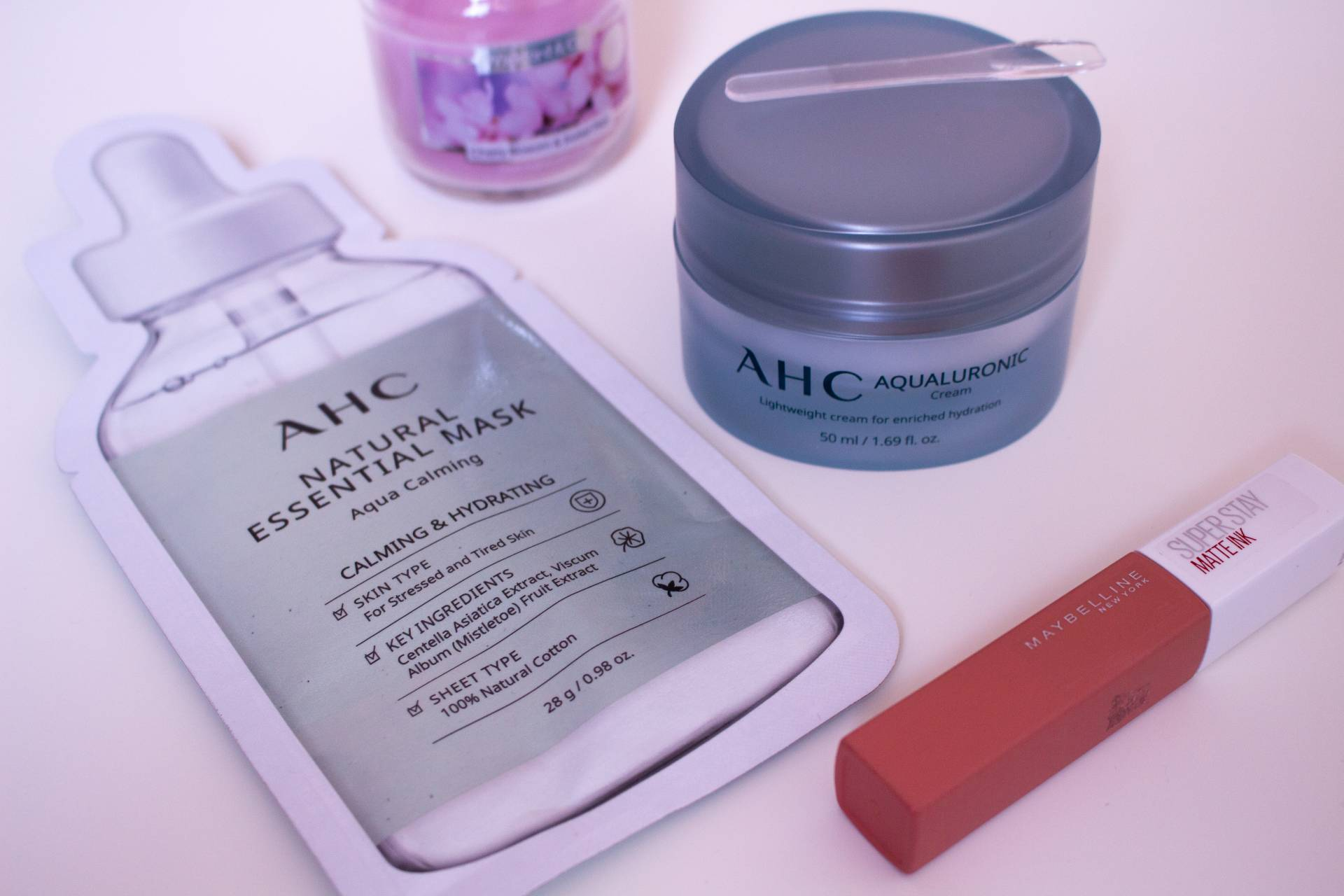 AHC Beauty Aqualuronic Cream and Calming Mask on flatlay