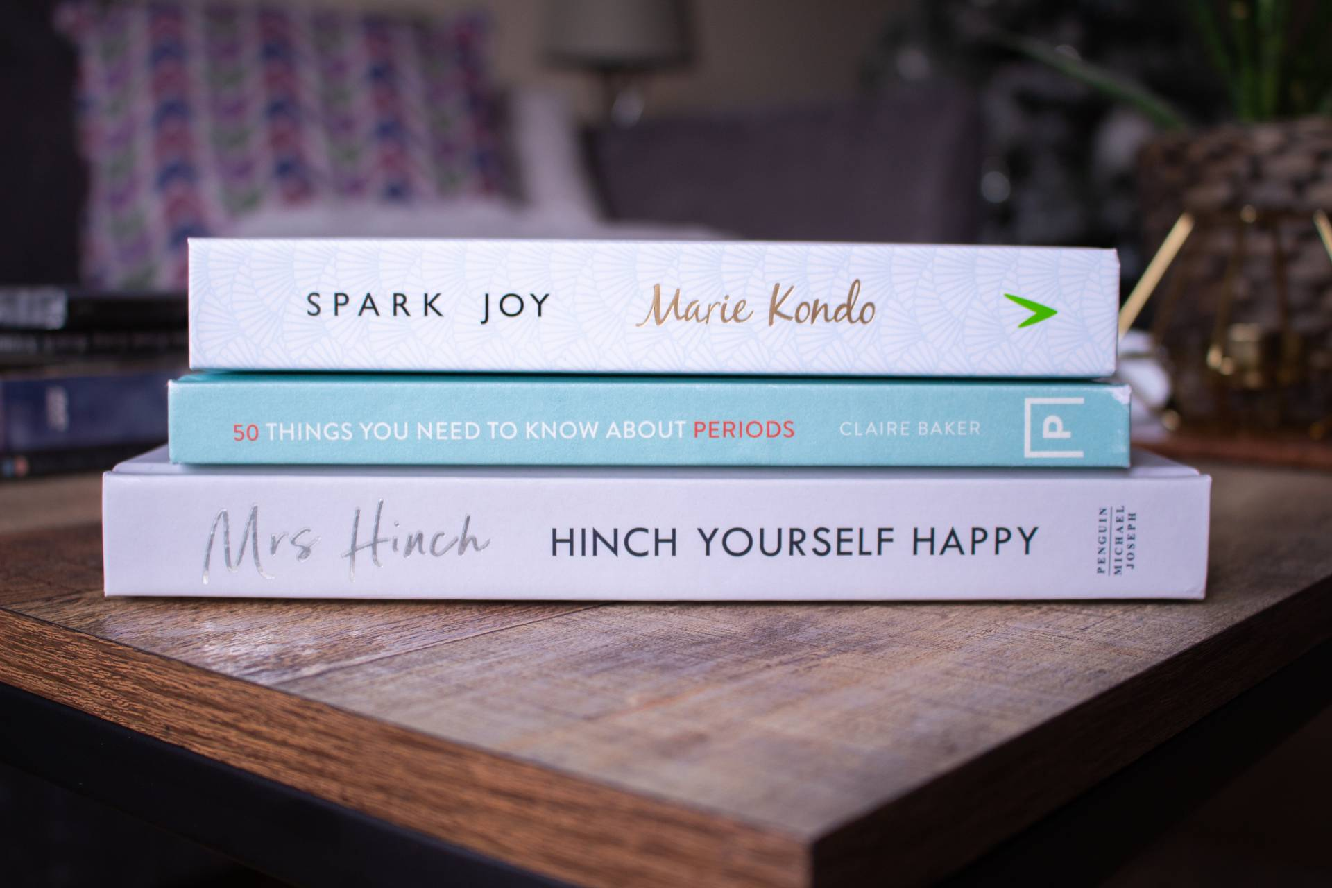 3 self help books on coffee table