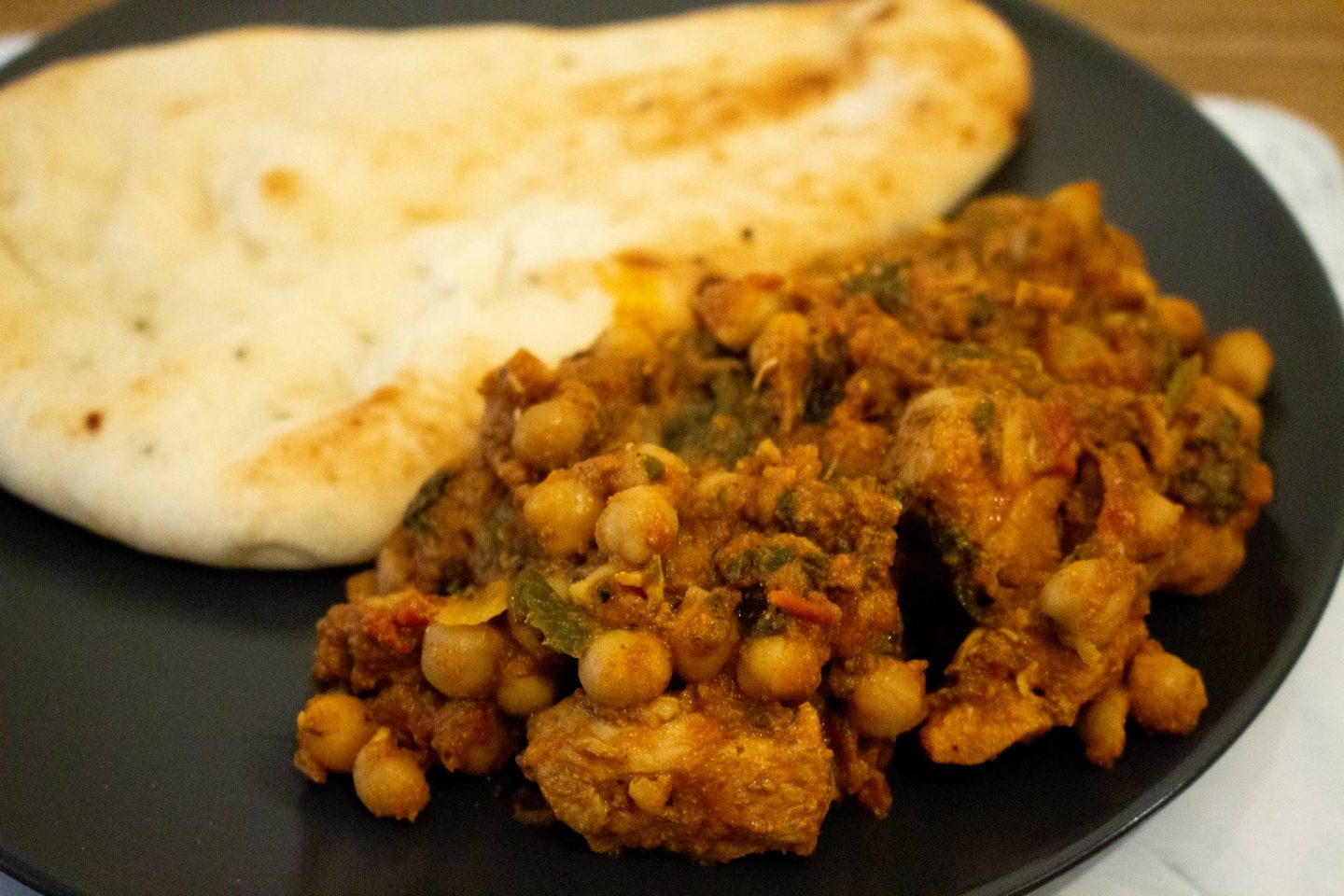 chicken and chickpea curry with naan bread