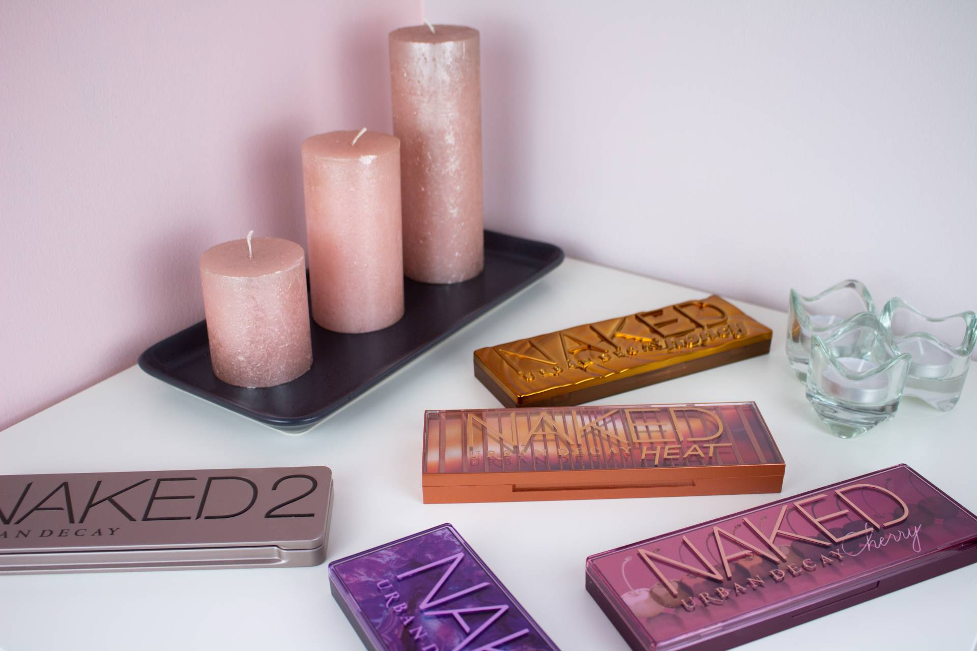 urban decay palettes on table with candles